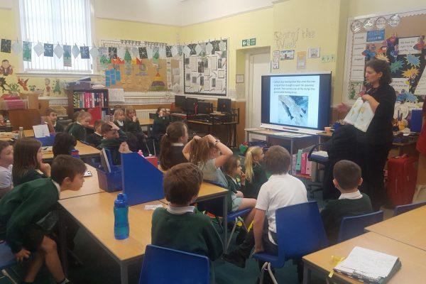 Daniele Muir in the classroom teaching children about salmon